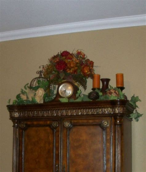decorating ideas for top of armoire tuscan style tuscan decor pinterest