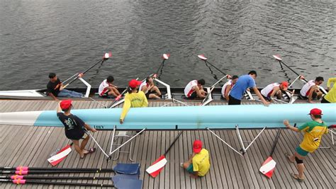 boat race game definition silhouettes of men s four rowing team at the start of a