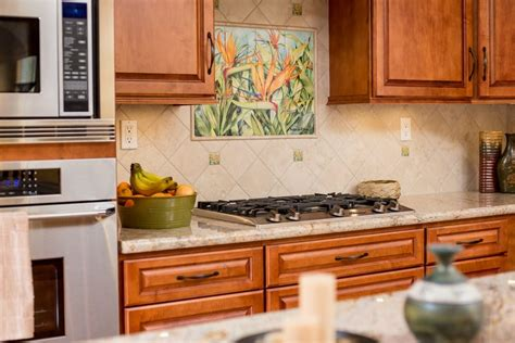 kitchen remodel with gas stove top and custom backsplash