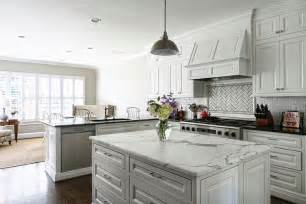 peninsula island kitchen kitchen with white mini subway tiles transitional kitchen