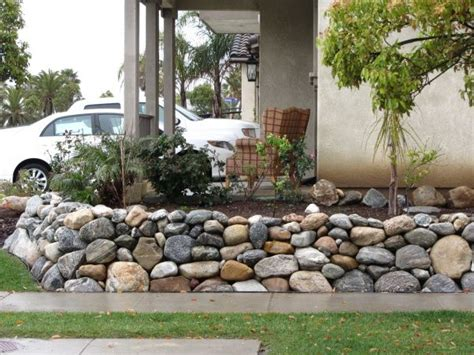 outdoor river rock retaining wall 70ft rock the house