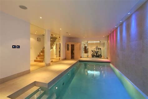 basement pool with glass walls home basement