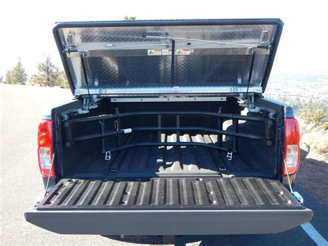 hard truck bed covers hard truck bed cover on a nissan frontier a rugged black