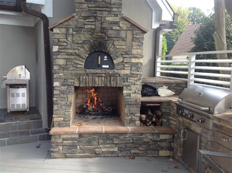 outdoor kitchen with fireplace outdoor kitchen designs archadeck of charlotte