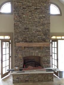 warm and cozy stone fireplace surrounds stone veneer natural stone fireplace pictures and ideas