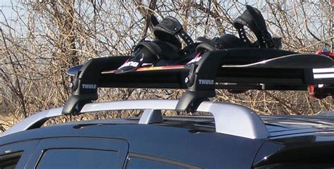 Wakeboard Roof Rack by Thule Snowcat Rooftop Ski And Snowboard Rack For