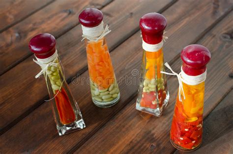 decorative vegetables in bottles decorative bottles filled with vegetables and spices stock