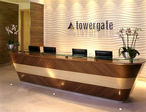 hotel reception desk design textured light colored wall with recessed lighting wood paneled desk w white marble top