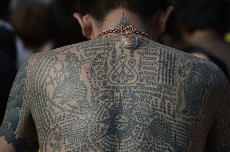 monk tattoo thousands gather in thailand to receive magical tattoos