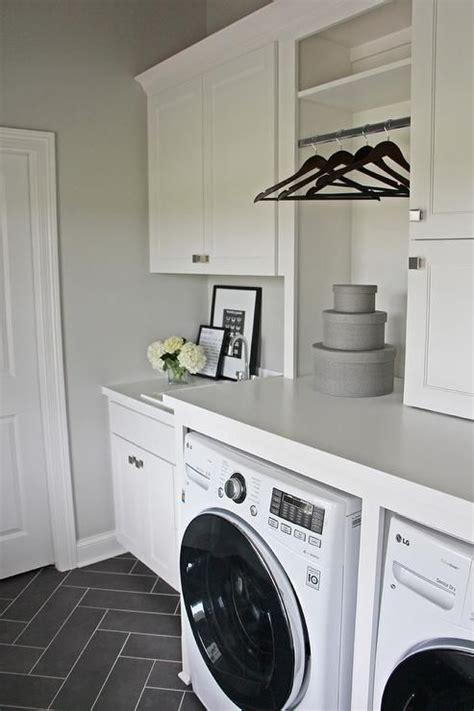 laundry room floor cabinets white laundry room with gray herringbone floor laundry