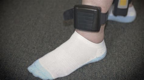 house arrest ankle bracelet reach out and guard someone rolling stone