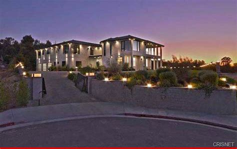 chris brown home robbery hostage held in