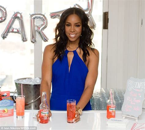kelly is the new vestal for our new ruler cult the kelly rowland dazzles in blue jumpsuit at seagram s
