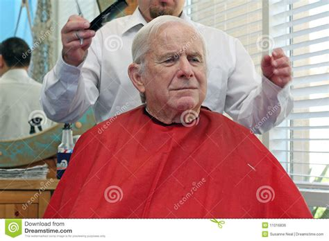 which day senior citizen haircut at cuts grandpa gets a haircut royalty free stock image image