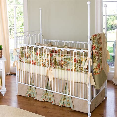 four poster iron crib in white and nursery necessities in