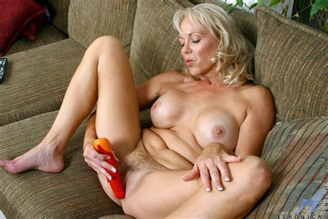 sexy Anilos cougar Veronica Wears Red Lingerie As She Starts To masturbate With A Dildo On The