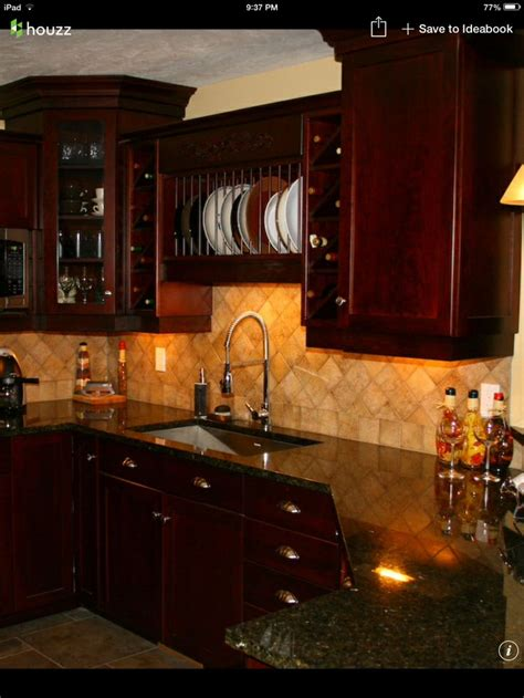 I'm really liking this look. Dark cherry cabinets, uba