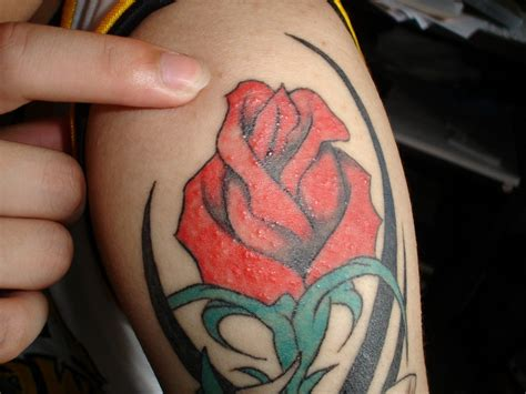 red and black rose tattoos black tribal and on half sleeve