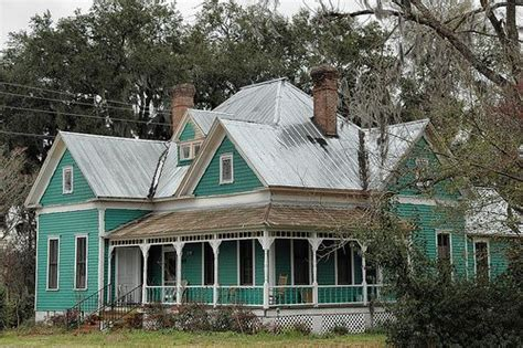 folk victorian folk victorian central avenue green house with silver tin roof victorian houses pinterest