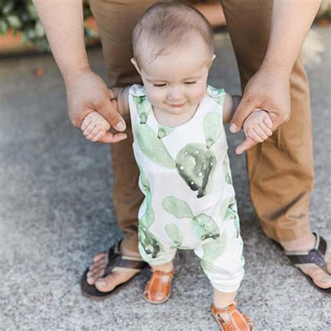 Baby Victory Printed victory check out my new cactus print sleeveless baby green jumpsuit snagged at a