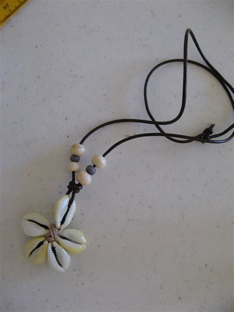 how to make shell jewelry how to make a cowrie shell flower azteca designs boutique