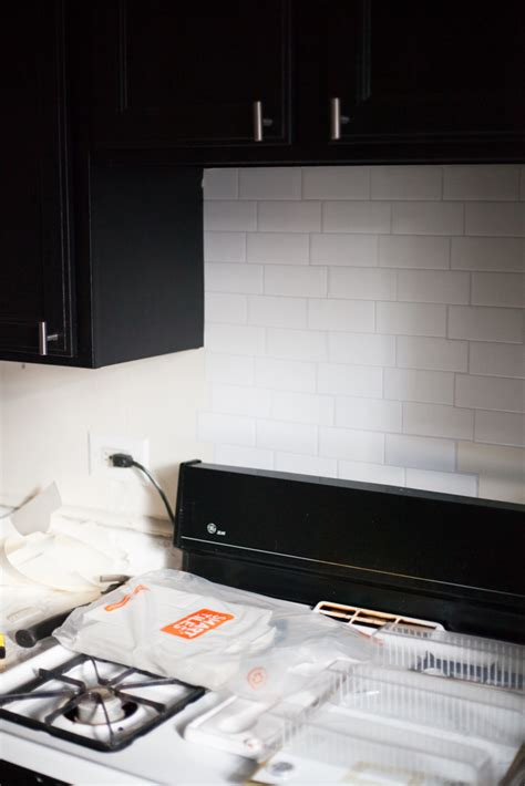 an easy stick on tile backsplash that s perfect for