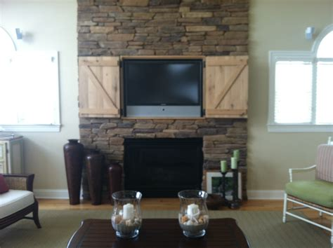 tv above fireplace hidden tv over fireplace open doors awww pinterest