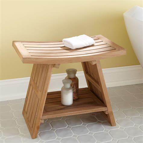 Shower Stool Has A Curving Seat And Slatted Design That Allows Water To Flow Through Crafted Of Water Resistant Durable Teak Wood This Shower Seat