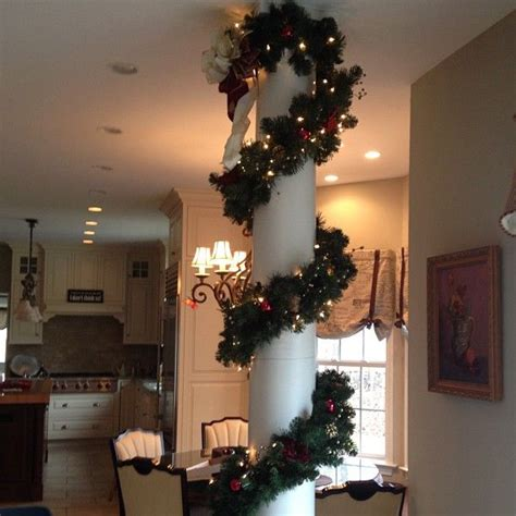 how to decorate indoor column for xmas garland and lights wrapping a column www neavedecor indoor decorating