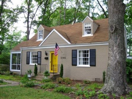 nice tan house  shutters pop  color   front