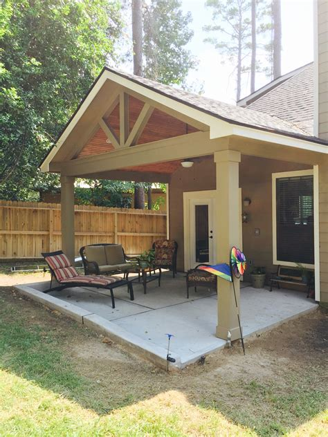 Gable roof patio cover with wood stained ceiling   Gable