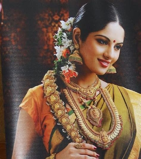 South Indian bride with temple jewellery,heavy jhumkas and hair jewellery..   South Indian