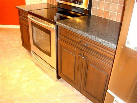 Black Laminate Kitchen Cabinets Cherry Cabinets With Black Glaze And Hd Laminate Tops