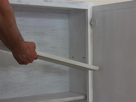 tv coverups turn a kitchen cabinet into a flat screen tv cover hgtv
