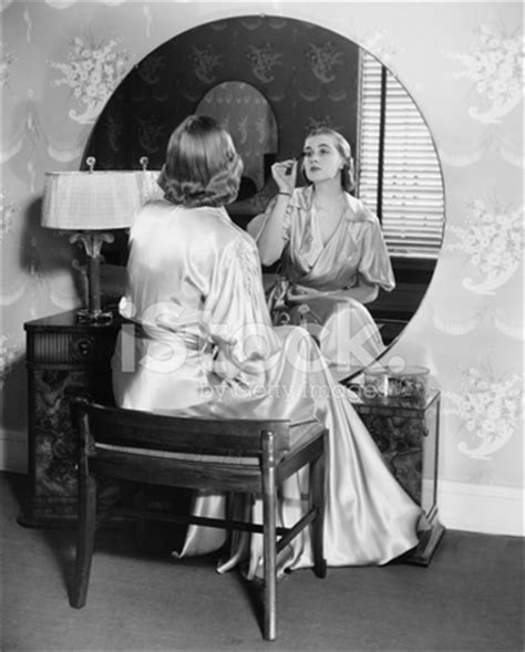 woman applying    front  vanity table bw