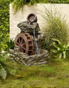 How To Turn Your Backyard Into An Oasis Garden Oasis Lighted Rock With Wheel Fountain Shop Your