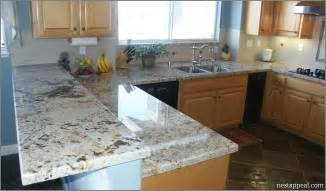 Granite Countertops For White Kitchen Cabinets - white ice granite sample affordable bathroom and kitchen