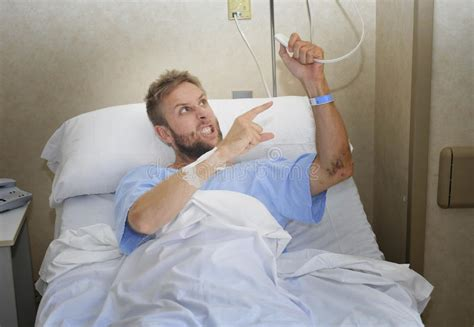 room spinning sensation when lying angry patient at hospital room lying in bed pressing call button feeling nervous and