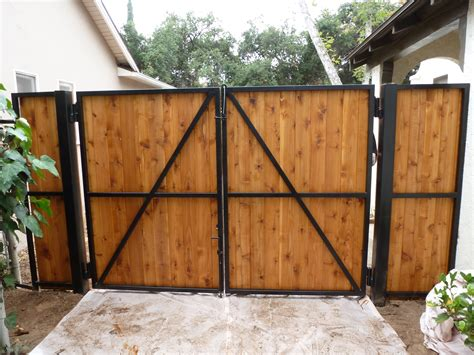wood swing gate wrought iron frame with wood overlay double swing gates