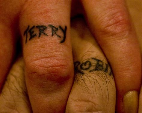 tattoo name band designs 40 of the best wedding ring tattoo designs