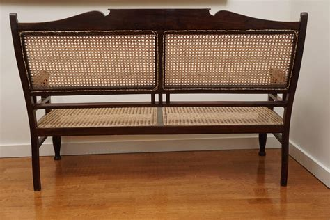 Antique Wooden Settee antique wood and caned settee at 1stdibs