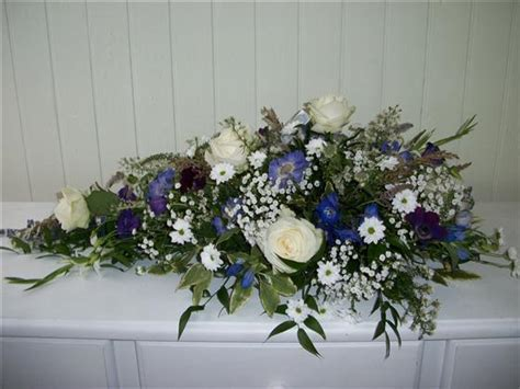 White and Purple Spray   Funeral Flowers Eastbourne