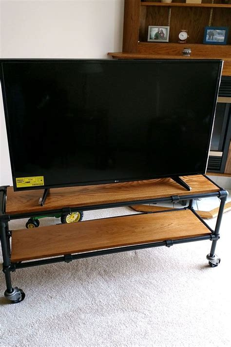 Plumbing Pipe Tv Stand by Diy Rolling Industrial Pipe Tv Stand Diy Entertainment