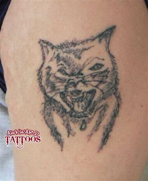 animal tattoo fail horrible wolf tattoo horrible tattoos pinterest