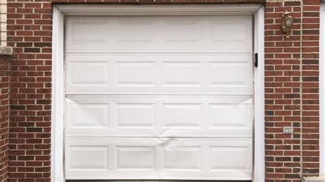 Door Panel Repair by Garage Door Repair Silver Garage Door Service Near Me
