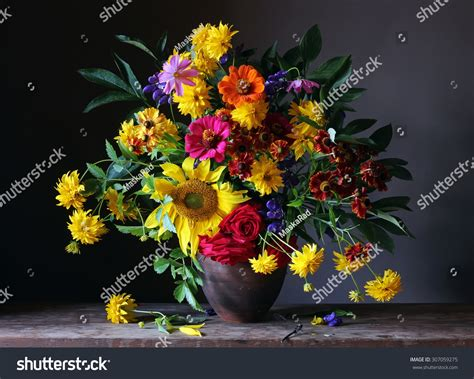 yellow and pink sunflowers flower bouquet from cultivated flowers with a sunflower roses