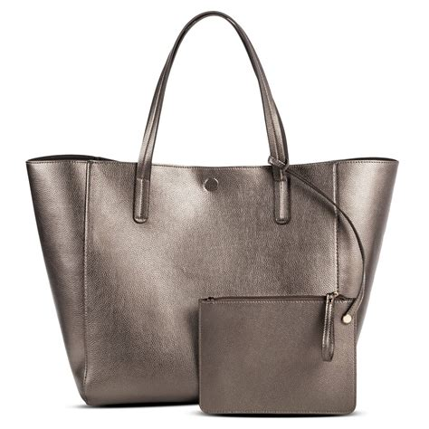 Faux Leather Tote With s reversible faux leather tote with removable pouch