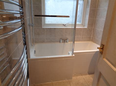 Bathroom Shower Bath Shower Bath Bathroom Suite Fitted With Tiled Walls And Floor