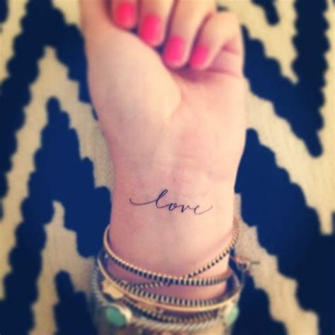 should i get a tattoo on my wrist small tattoos and font simple feminine tats should