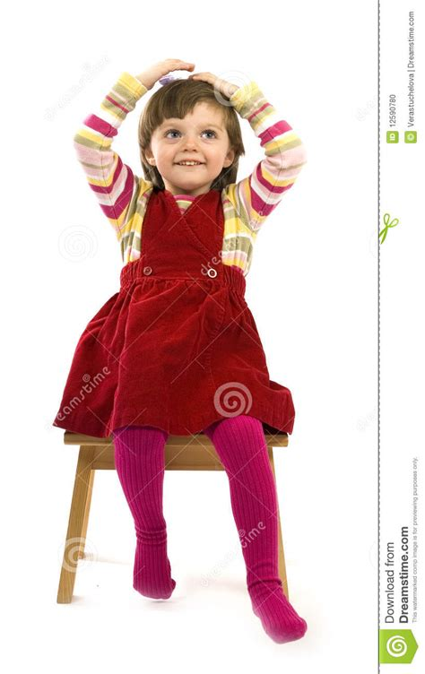 little girl on chair nice little girl on a chair stock photo image 12590780